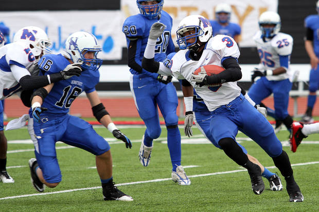 HIGH SCHOOL FOOTBALL PLAYOFFS: Millwood's Cameron Batson runs towards the sidelines as Hennessey's Levi Hill (16) chases during the Class 2A semifinals between Millwood and Hennessey in Yukon, Saturday, December 3 2011. PHOTO BY HUGH SCOTT, FOR THE OKLAHOMAN ORG XMIT: KOD