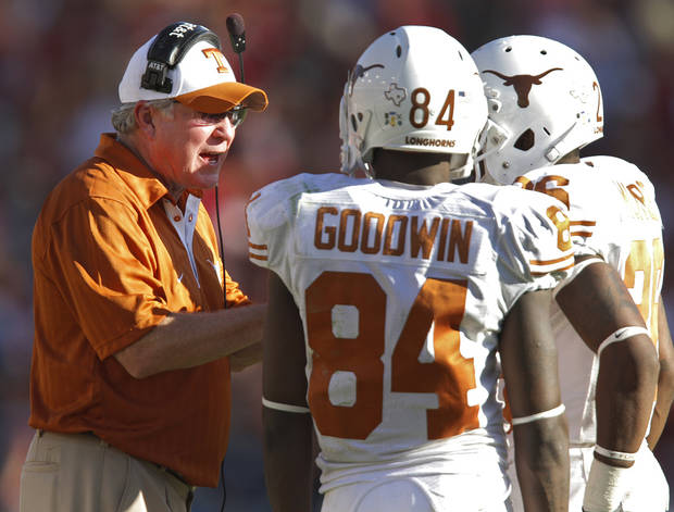 Texas coach Mack Brown talks to his players in the second half of the Red River Rivalry college football game between the University of Oklahoma Sooners (OU) and the University of Texas Longhorns (UT) at the Cotton Bowl on Saturday, Oct. 2, 2010, in Dallas, Texas.   Photo by Chris Landsberger, The Oklahoman