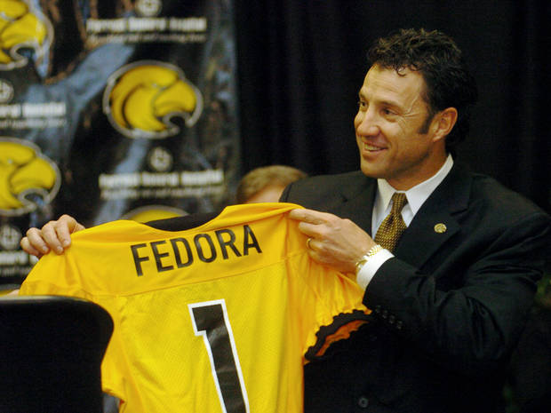 SOUTHERN MISSISSIPPI UNIVERSITY / COLLEGE FOOTBALL: Larry Fedora holds up a jersey with his name printed on it after being named the new head football coach at Southern Miss, Wednesday, Dec. 12, 2007, in Hattiesburg, Miss. He was the offensive coordinator at Oklahoma State University (OSU). (AP Photo/Steve Coleman)                               ORG XMIT: MSSC101