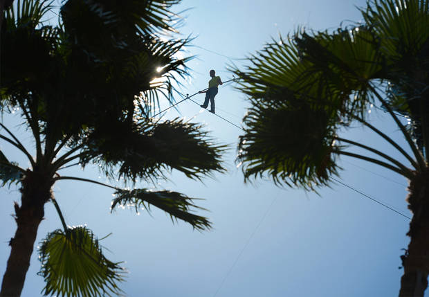 Aerialist Nick Wallenda walks the high wire 200 feet over U.S. 41 in Sarasota, Fla., without a safety harness on Tuesday, Jan. 29, 2013.  The Sarasota City Commission is allowing him to do the stunt without a tether. Wallenda wore a tether for the first time last summer when he walked across Niagara Falls because the television network that was paying for the performance insisted on it. (AP Photo/Sarasota Herald-Tribune, Dan Wagner)  PORT CHARLOTTE OUT; BRADENTON HERALD OUT; TV OUT;  ONLINE OUT