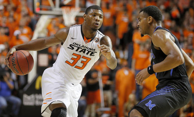 Oklahoma State's Marcus Smart (33) goes around Memphis' Chris Crawford (3) during an NCAA college basketball game between Oklahoma State and Memphis at Gallagher-Iba Arena in Stillwater, Okla., Tuesday, Nov. 19, 2013. Photo by Bryan Terry, The Oklahoman