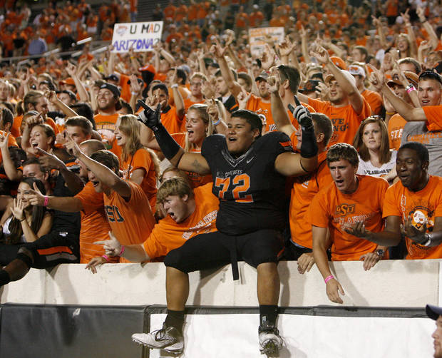 Oklahoma State's Christian Littlehead celebrats with fans after the Cowboys beat Arizona 37-14 on Thursday. PHOTO BY BRYAN TERRY, The Oklahoman