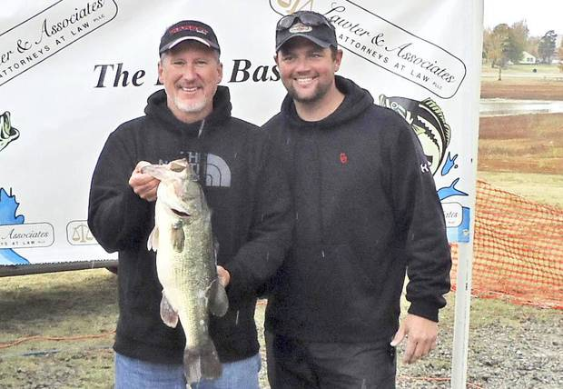 Bill Bean of Eufaula and Nick Aber of Piedmont won big bass honors at the Last Bass Tournament on Lake Eufaula with a 7.4 pound largemouth. PHOTO PROVIDED