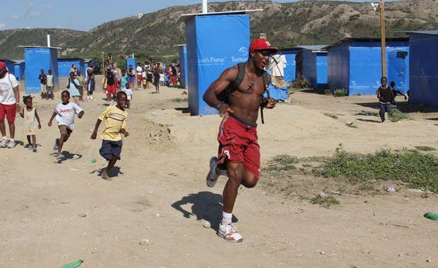 OU receiver Justin McCay runs on a recent trip to Haiti. Photo by Michael Davis.