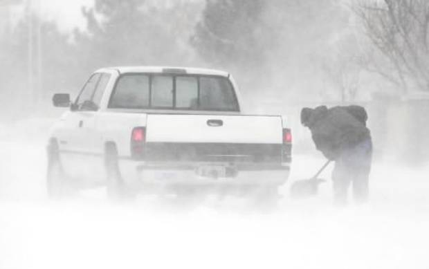 A stranded motorist tries to dig out his truck on 15th just west of Broadway in Edmond, Wednesday, February 1, 2011. Photo by David McDaniel