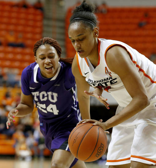 Oklahoma State's Kendra Suttles (31) gains control of the ball beside TCU's Natalie Ventress (24) during a women's college basketball game between Oklahoma State University and TCU at Gallagher-Iba Arena in Stillwater, Okla., Tuesday, Feb. 5, 2013. Oklahoma State won 76-59.  Photo by Bryan Terry, The Oklahoman