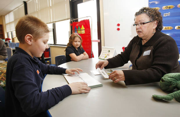 Special-education teacher Linda Felton works with Gabriel Brown, 8, left, and Zada Lamb, 7, during a class for autistic children at Sequoyah Elementary School in Oklahoma City on Thursday. Photo by Paul Hellstern, The Oklahoman
