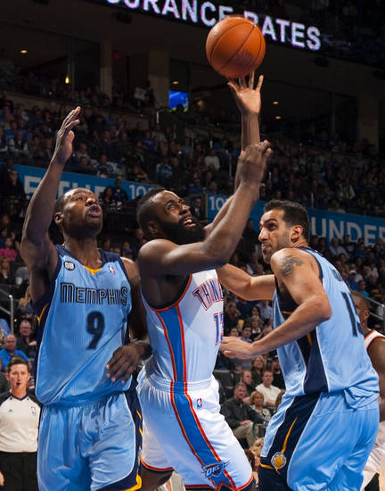 Oklahoma City's James Harden (13) goes between Memphis' Tony Allen (9) and Hamed Haddadi (15) during the NBA game between the Oklahoma City Thunder and the Memphis Grizzlies at Chesapeake Energy Arena in Oklahoma CIty, Friday, Feb. 3, 2012. Photo by Bryan Terry, The Oklahoman