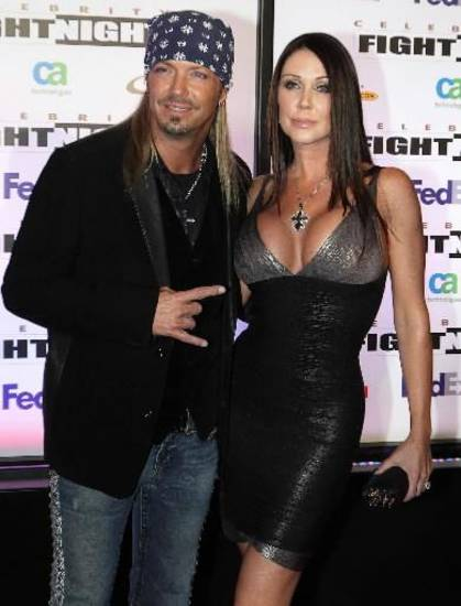 "This March 19, 2011 file photo shows singer Bret Michaels and his girlfriend Kristi Gibson at Muhammad Ali Celebrity Fight Night XVII in Phoenix. Michaels and his longtime girlfriend Kristi Gibson have called off their engagement. Michael's publicist, Joanna Mignano, said in a statement Monday, July 30, 2012, that the couple has separated. Michaels and Gibson have dated on- and off-again for about 18 years. They have two daughters, Raine Elizabeth and Jorja Bleu. The statement reads that the parents will ""remain great friends and are committed to jointly raising"" their daughters. (AP Photo/Darryl Webb, file)"