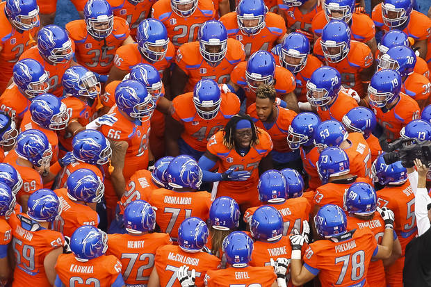 Boise State running back Jay Ajayi (27) talks to his teammates before an NCAA college football game against Fresno State in Boise, Idaho, on Friday, Oct. 17, 2014. (AP Photo/Otto Kitsinger)