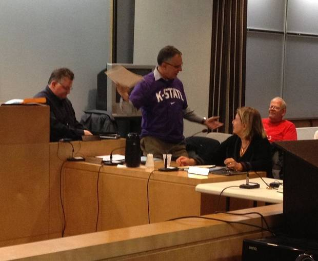 Morgantown, W.Va., Mayor Jim Manilla wore a Kansas State shirt to the Oct. 30 city council meeting to pay up on the friendly wager he lost when the Wildcats beat West Virginia 55-14. PHOTO PROVIDED BY CITY OF MORGANTOWN
