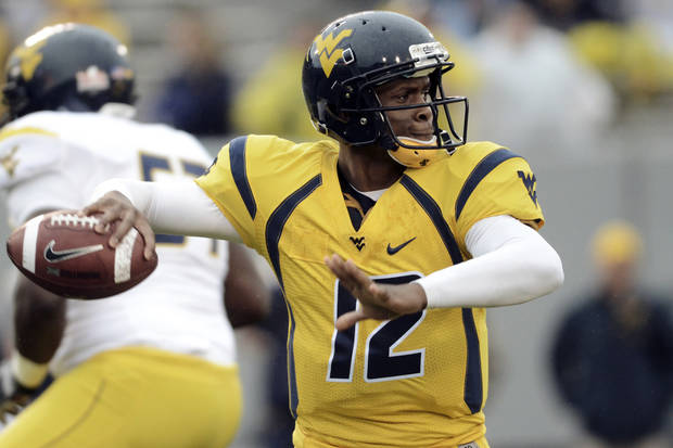 West Virginia University's Geno Smith looks for a receiver during their spring NCAA college football game, Saturday, April 21, 2012, in Morgantown, W.Va. (AP Photo/Jeff Gentner) ORG XMIT: WVJG103