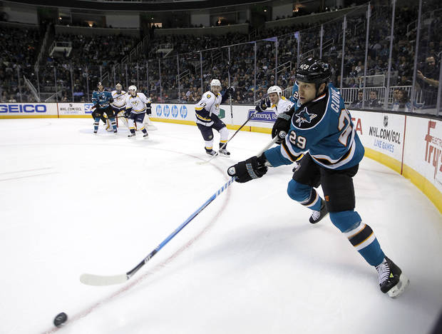 San Jose Sharks right wing Ryane Clowe (29) passes the puck against Nashville Predators during the first period of an NHL hockey game in San Jose, Calif., Saturday, March 2, 2013. (AP Photo/Tony Avelar)