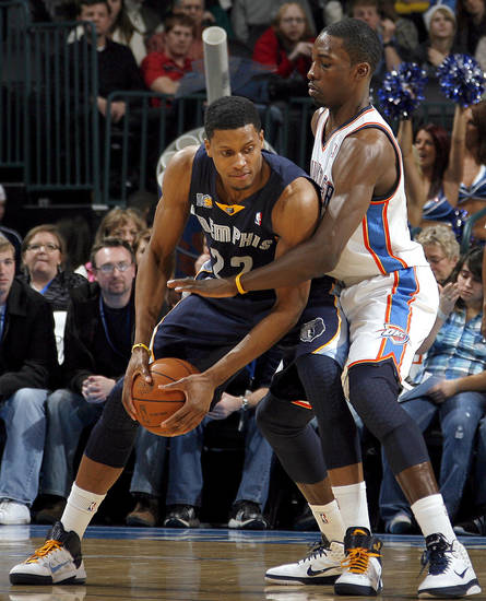 Oklahoma City's Jeff Green (22) defends Memphis'  Rudy Gay during the NBA basketball game between the Oklahoma City Thunder and the Memphis Grizzlies, Saturday, Jan. 8, 2011, at the Oklahoma City Arena. Photo by Sarah Phipps, The Oklahoman