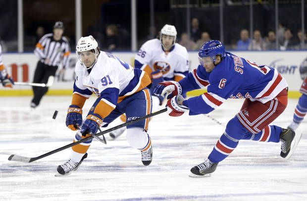 New York Rangers' Anton Stralman, right, tries to block a pass by New York Islanders' John Tavares during the first period of the NHL hockey game in New York, Thursday, Feb. 7, 2013.  (AP Photo/Seth Wenig)