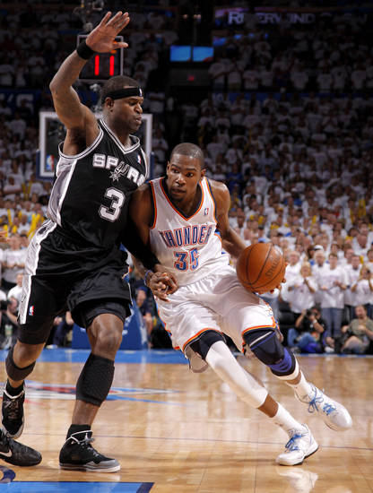 Oklahoma City's Kevin Durant (35) goes past San Antonio's Stephen Jackson (3) during Game 6 of the Western Conference Finals between the Oklahoma City Thunder and the San Antonio Spurs in the NBA playoffs at the Chesapeake Energy Arena in Oklahoma City, Wednesday, June 6, 2012. Oklahoma City won 107-99. Photo by Bryan Terry, The Oklahoman