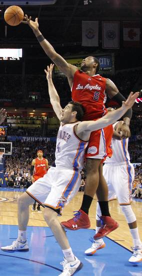 Los Angeles Clippers center DeAndre Jordan (6) goes over Oklahoma City Thunder power forward Nick Collison (4) to put up a shot during the NBA basketball game between the Oklahoma City Thunder and the Los Angeles Clippers at Chesapeake Energy Arena on Wednesday, March 21, 2012 in Oklahoma City, Okla.  Photo by Chris Landsberger, The Oklahoman