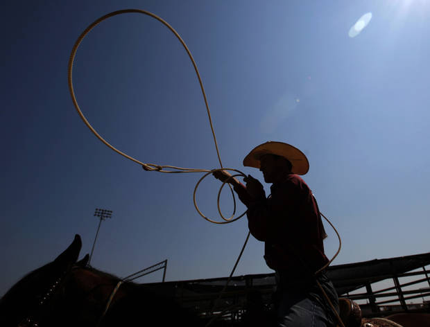 Lane Livingston of Seymour, Texas, warms up for calf roping during day four of the International Youth Finals Rodeo at the Shawnee Expo Center in Shawnee, Okla, Wednesday, July 11, 2012. Photo by Sarah Phipps, The Oklahoman