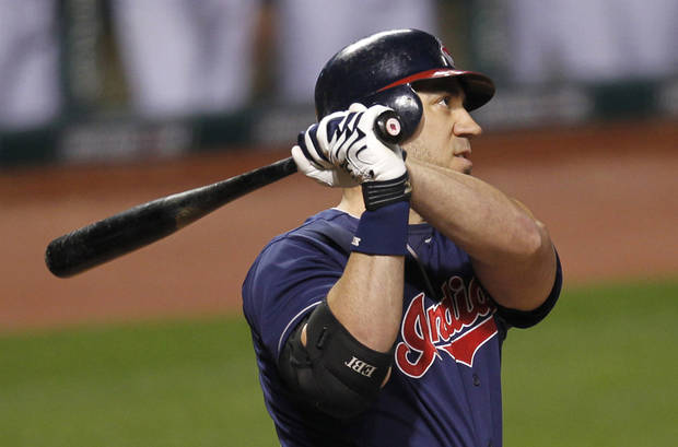 Cleveland Indians' Travis Hafner watches his two-run home run off Chicago White Sox starting pitcher Jake Peavy in the ninth inning of a baseball game, Tuesday, Oct. 2, 2012, in Cleveland. Jason Donald scored. (AP Photo/Tony Dejak)