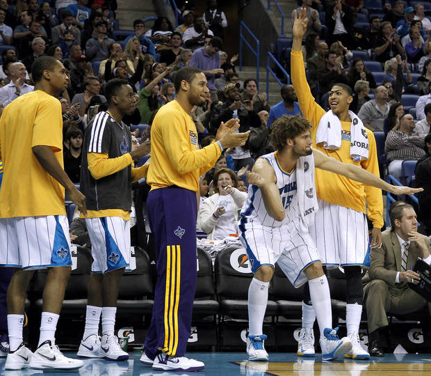 The New Orleans Hornets celebrate during the second half of an NBA basketball game against the Houston Rockets in New Orleans, Wednesday, Jan. 9, 2013. The Hornets won 88-79. (AP Photo/Jonathan Bachman)