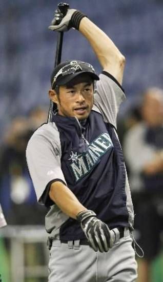 Seattle Mariners' Ichiro Suzuki prepares for a batting practice during the team's training for the season-opening game against Oakland Athletics, at Tokyo Dome ball stadium in Tokyo, Saturday, March 24, 2012. (AP Photo/Kyodo News)