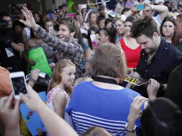 The Swon Brothers, from left, Colton and Zach Swon, are greeted by fans as they get off of a bus at the Civic Center in Muskogee, Okla., Thursday, June 6, 2013. Photo by Garett Fisbeck/Tulsa World