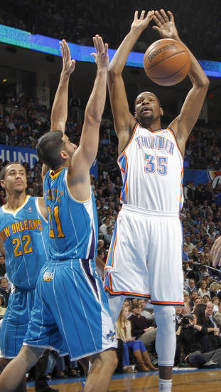 New Orleans Hornets' Greivis Vasquez (21) fouls Oklahoma City Thunder's Kevin Durant (35) during the NBA basketball game between the Oklahoma CIty Thunder and the New Orleans Hornets at the Chesapeake Energy Arena on Wednesday, Dec. 12, 2012, in Oklahoma City, Okla.   Photo by Chris Landsberger, The Oklahoman