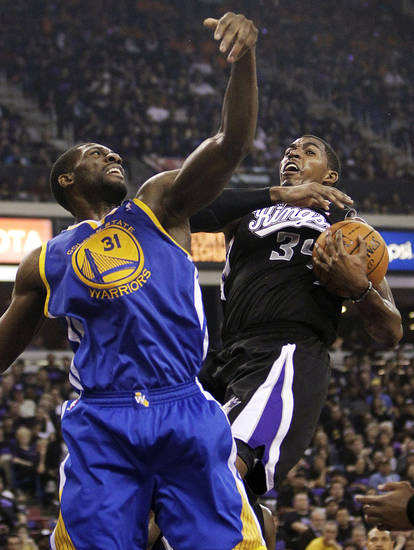 Sacramento Kings forward Jason Thompson, right, pulls the rebound away from Golden State Warriors center Festus Ezeli, of Nigeria, during the first half of an NBA basketball game in Sacramento, Calif., Monday, Nov. 5, 2012. (AP Photo/Rich Pedroncelli)