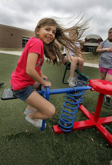 Kennedy Hammer and other students at Truman Primary School play outside in warm weather on Wednesday, March 14, 2012, in Norman, Okla.   Photo by Steve Sisney, The Oklahoman