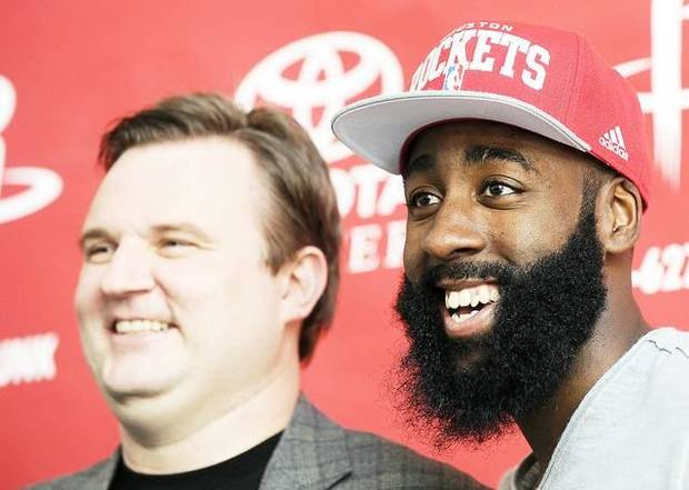 Houston Rockets general manager Daryl Morey, left, introduces Houston guard and former Thunder star James Harden on Monday. AP PHOTO