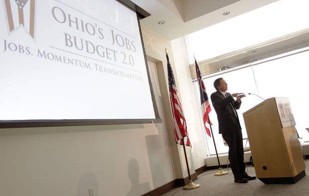 Ohio Gov. John Kasich answers questions about the fiscal year 2014-15 executive budget proposal during a news conference Monday, Feb. 4, 2013, in Columbus, Ohio. (AP Photo/Jay LaPrete)