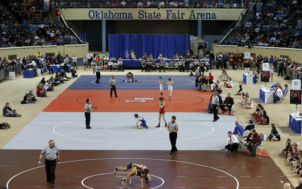 Wrestlers compete during the state wrestling championships at the State Fair Arena in Oklahoma City, Saturday, Feb. 23, 2013. Photo by Bryan Terry, The Oklahoman