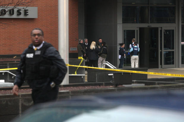 Police confer outside the New Castle County Courthouse,  Monday morning, Feb. 11, 2013, in Wilmington, Del. , after a man killed his estranged wife and two others at the courthouse.  The mayor of Wilmington says police have killed the gunman.  (AP Photo/The News Journal/William Bretzger)  PHILADELPHIA TV OUT AND PHILADELPHIA ONLINE SITES OUT