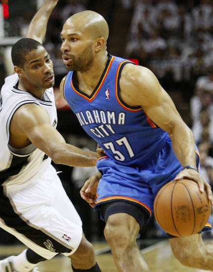Oklahoma City's Derek Fisher (37) goes past San Antonio's Gary Neal (14) during Game 5 of the Western Conference Finals between the Oklahoma City Thunder and the San Antonio Spurs in the NBA basketball playoffs at the AT&T Center in San Antonio, Monday, June 4, 2012. Photo by Nate Billings, The Oklahoman