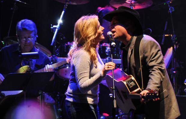 Trisha Yearwood and Garth Brooks perform at the tribute concert for the late George Jones, Friday, Nov. 22, 2013, in Nashville, Tenn. (AP file)
