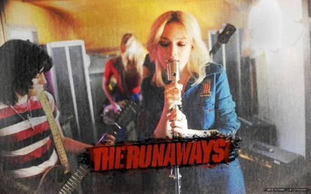 "Kristen Stewart, left, as Joan Jett, and Dakota Fanning as Cherie Currie in ""The Runaways."""