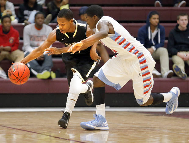 HIGH SCHOOL BASKETBALL TOURNAMENT: Midwest City's Torey Noel tries to get by Lawton Ike's Keyshawn Perkins during the championship game between Lawton Eisenhower and Midwest City at the Putnam City Invitational at Putnam City North High School in Oklahoma CIty,  Saturday,Nov. 2, 2013. Photo by Sarah Phipps, The Oklahoman