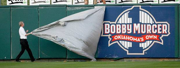 A Bobby Murcer banner is revealed before the Oklahoma City RedHawks home opener against the Memphis Redbirds at the Bricktown Ballpark in Oklahoma City, Friday, April 17, 2009. Photo by Bryan Terry, The Oklahoman