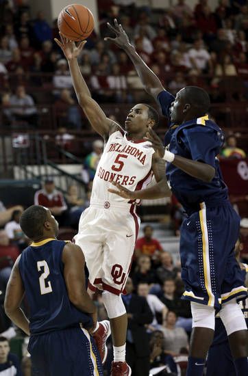 Sooner Je'lon Hornbeak shoots guarded by June Carter (32) as the University of Oklahoma (OU) Sooners men's basketball team plays the Central Oklahoma Bronchos at McCasland Field House on Wednesday, Nov. 7, 2012  in Norman, Okla. Photo by Steve Sisney, The Oklahoman