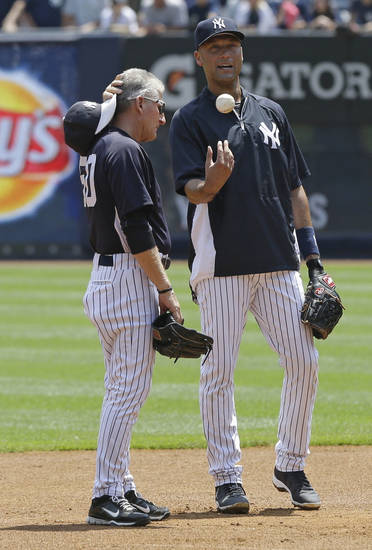 New York Yankees' Derek Jeter, right, talks with first base coach Mick Kelleher during batting practice before a baseball game against the Tampa Bay Rays Saturday, June 22, 2013, in New York. (AP Photo/Frank Franklin II)