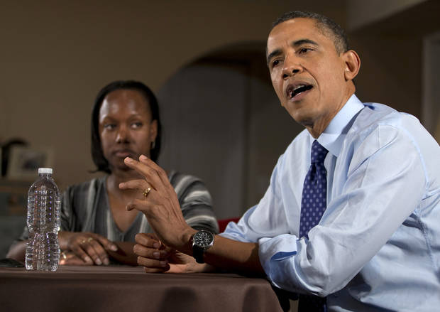 President Barack Obama gestures as he speaks to the media during a visit with high school English teacher Tiffany Santana, left, and others, Thursday, Dec. 6, 2012, in Falls Church, Va., to discuss the importance of extending income tax cuts and small businesses. (AP Photo/Carolyn Kaster)
