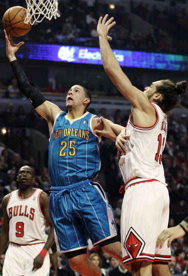 New Orleans Hornets guard Austin Rivers (25) drives to the basket against Chicago Bulls center Joakim Noah (13) during the first half of an NBA basketball game in Chicago, Saturday, Nov. 3, 2012. (AP Photo/Nam Y. Huh)