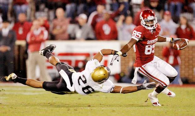 OU's Ryan Broyles (85) gets past Ray Polk (26) of Colorado after a catch in the first quarter during the college football game between the University of Oklahoma Sooners and the University of Colorado Buffaloes at Gaylord Family-Oklahoma Memorial Stadium in Norman, Okla., Saturday, October 30, 2010. Photo by Nate Billings, The Oklahoman