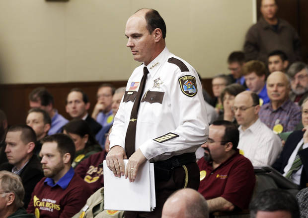 Hennepin County Sheriff Rich Stanek arrives before a packed hearing room to testify before a house public safety committee hearing testimony at the State Capitol on two bills dealing with the gun violence issue Tuesday, Feb. 5, 2013 in St. Paul, Minn. (AP Photo/Jim Mone)