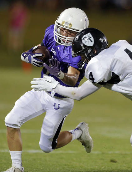 Bethany's John Page is tackled by Perkins Caleb White during the high school football game between Bethany High School and Perkins in Bethany, Okla., Friday, Sept. 28, 2012.  Photo by Sarah Phipps, The Oklahoman