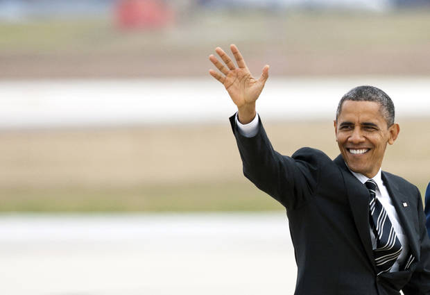 <p>President Barack Obama waves as he walks to Air Force One at Andrews Air Force Base, Md., Thursday, Nov. 15, 2012, en route to New York to visit areas devastated by Superstorm Sandy. (AP Photo/Cliff Owen)</p>