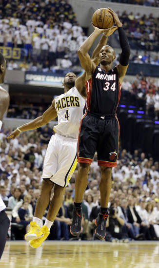 Miami Heat's Ray Allen (34) puts up a shot against Indiana Pacers' Sam Young (4) during the first half of Game 3 of the NBA Eastern Conference basketball finals in Indianapolis, Sunday, May 26, 2013. (AP Photo/Nam H. Huh)