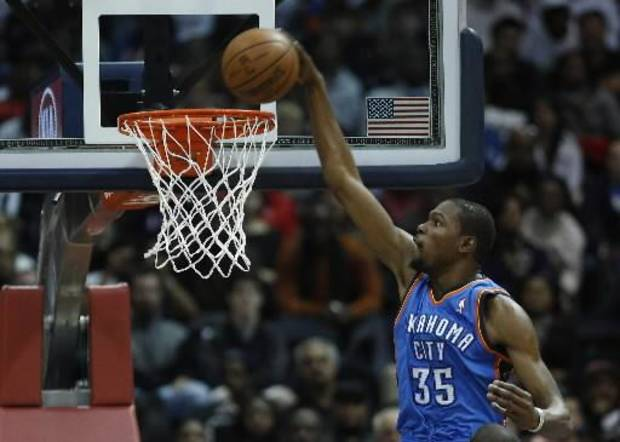 Oklahoma City Thunder small forward Kevin Durant (35) scores in the first half of an NBA basketball game against the Atlanta Hawks, Wednesday, Dec. 19, 2012, in Atlanta. (AP)