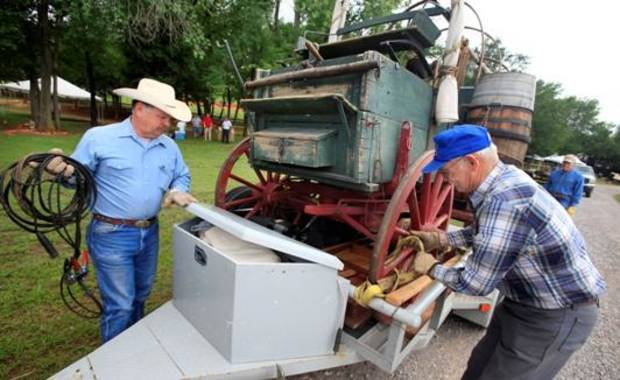 Jack Ramey, from Mustang, and Bill Nuzum, from El Reno, preparing to unload a chuck wagon from a trailer Wednesday, May 25, 2011, for the Chuck Wagon Gathering and Children's Cowboy Festival this weekend at the National Cowboy and Western Heritage Museum in Oklahoma City. Photo by Paul B. Southerland, The Oklahoman