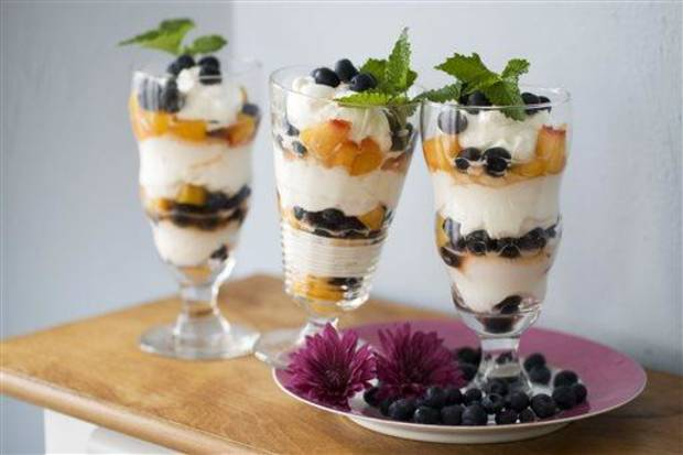 In this image taken on April 15, 2013, easy blueberry-peach mousse parfaits are shown in Concord, N.H. (AP Photo/Matthew Mead)